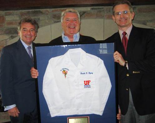 Drs Mark Gold and Bruce Kone present White Coat to Don Dizney